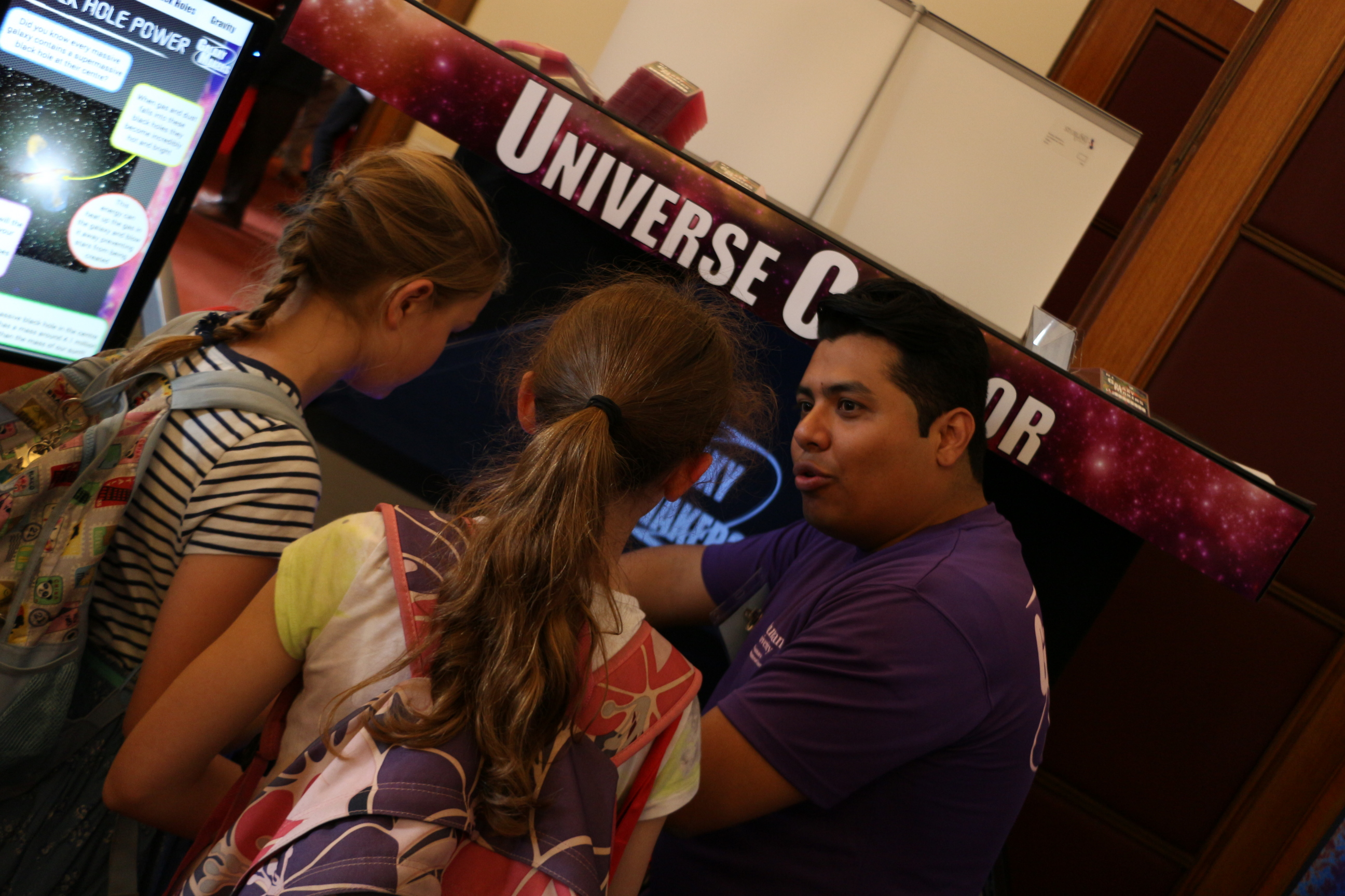 People using the explore the Universe exhibit
